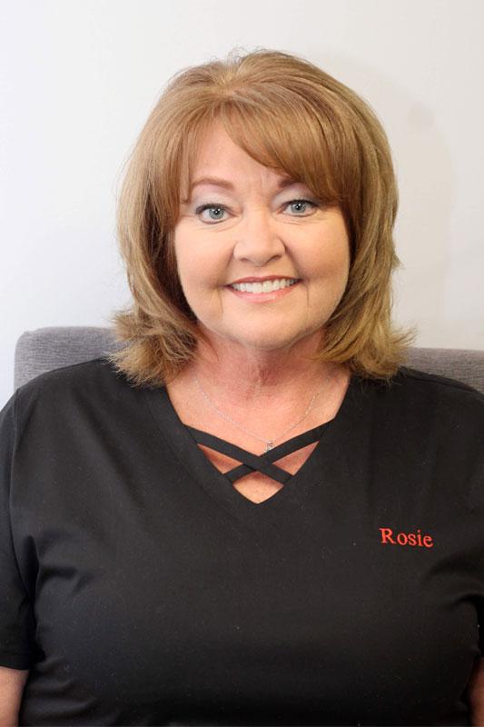 woman smiling at camera dental assistant