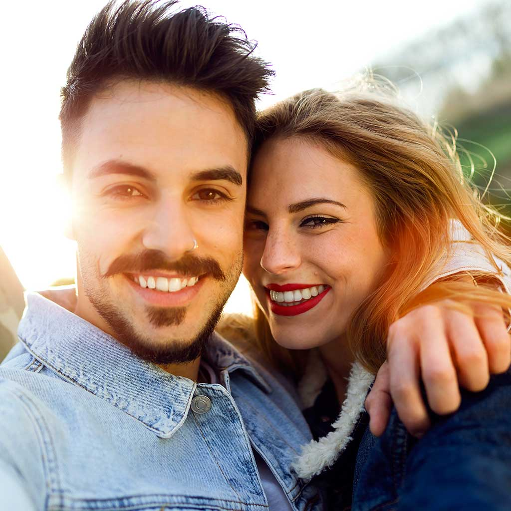 picture of young couple smiling at camera