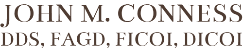 black logo of John M. Conness DDS, FAGD, FICOI, DICOI